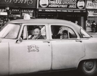 Taxicab driver at the wheel with two passengers, NYC 1956 © The Estate of Diane Arbus, LLC. All Rights  Reserved
